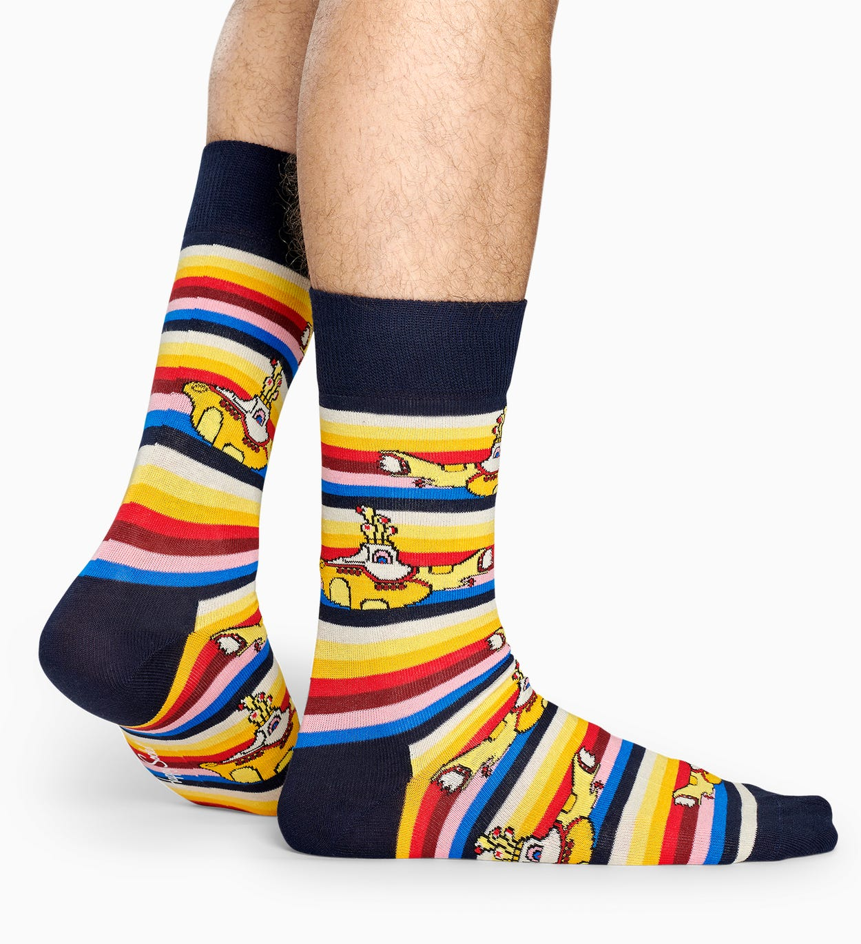 All aboard! This exclusive Beatles All On Board Sock comes in a sea of yellow, blue and red colors. Featuring the iconic Yellow Submarine, this smooth, …